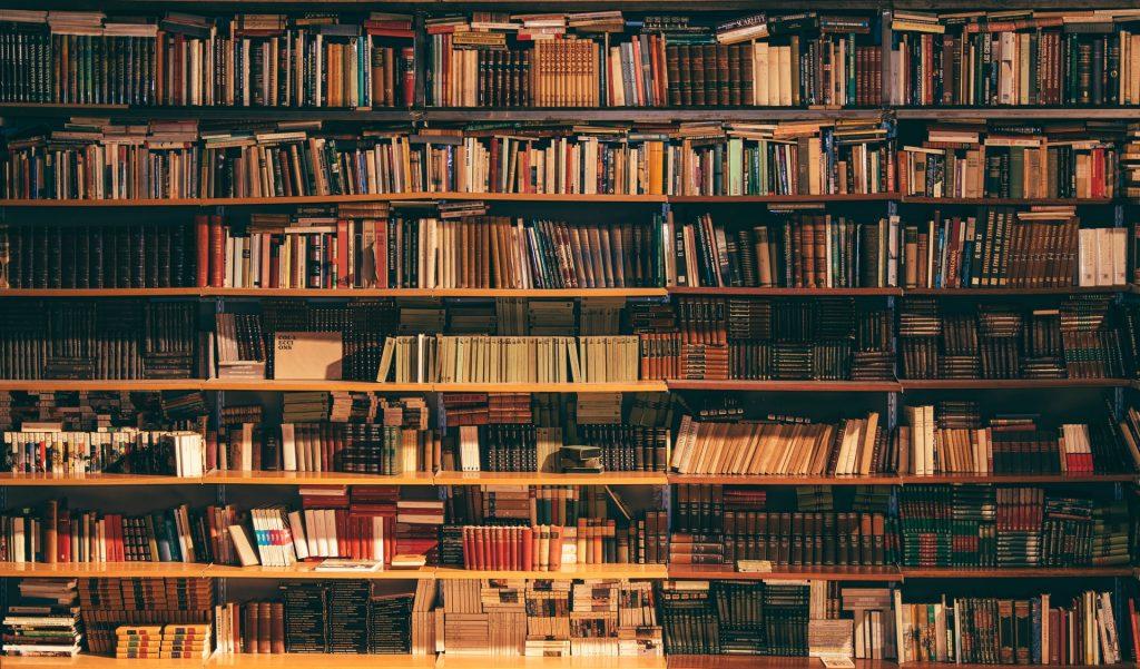 rows of full bookshelves