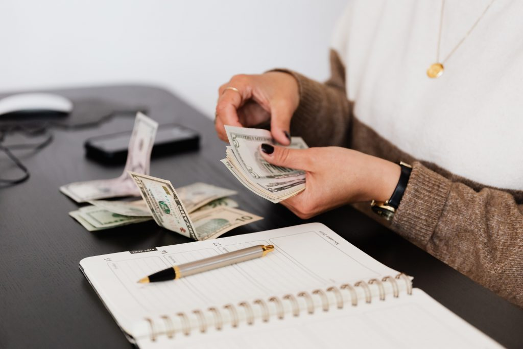 woman counting cash