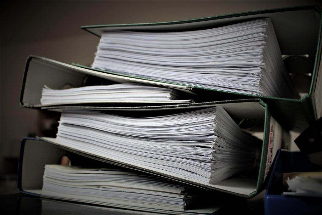 Stack of binders full of paper